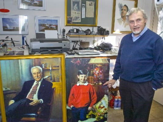Dean Paules talks with a visitor to his York Township studio in January 2010 about painting the former head of NASA, Sean O'Keefe, left, and Greg Pool III.