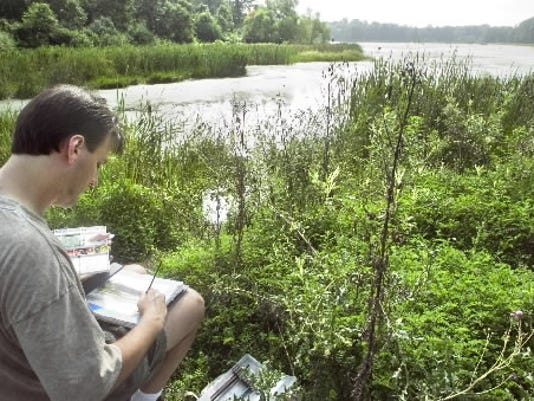 Jason Tako works on a watercolor sketch in August 2004 at State Game Lands No. 242 in Warrington Township.