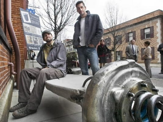 Patrick Sells, left, and Matthew Shober with a bench created by Sells in November 2010. Shober created a bench a block away.