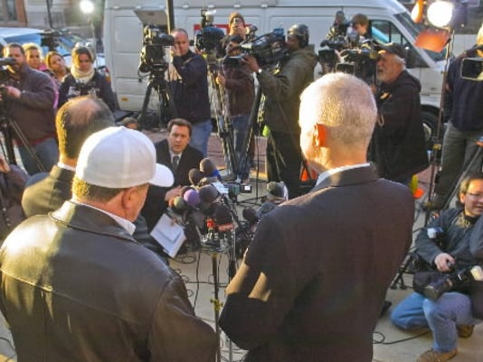 Craig Trebilcock, right, one of Albert Snyder's attorneys, speaks at a news conference Wednesday in York. He said the justices sidestepped one of the core issues in the case: Westboro using the Internet to target Snyder's family. Snyder is at center, and attorney Sean Summers, who argued before the court in October, is to his left. Summers said: 'The opinion today took away the precedential lines of public versus private figures.'