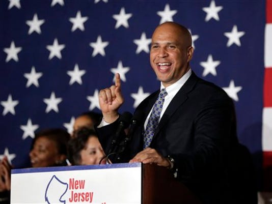 Sen. Cory Booker, D-N.J., addresses supporters during an election night victory gathering, Tuesday, Nov. 4, 2014, in Newark. (AP Photo/Julio Cortez)
