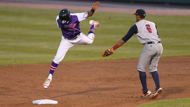 Rochester's Eddie Rosario can't escape the tag by Toledo's Dixon Machado as Rosario is caught stealing .