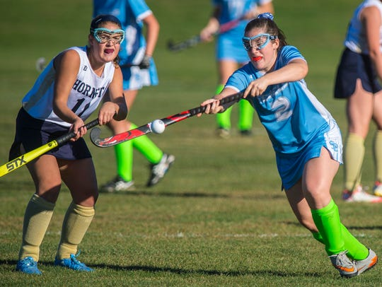 Essex's Maddie Reed, left, and South Burlington's Kate