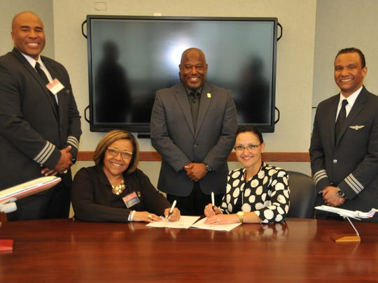 From front, left: DSU College of Business Dean Donna Covington, Lynette Darnell, Piedmont cadet program manager; and standing from left: First Officer Robert Barkers of American Airlines; Lt. Col. Michael Hales, director of DSU Aviation and First Officer Antonio Verges, of American Airlines.