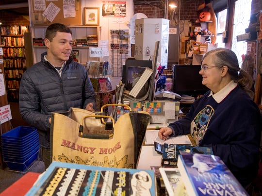 """Jon Whitman of Evansville, left, gets gift title suggestions from """"Book Nook"""" owner Wynne Beck Friday afternoon. Beck has put her business, """"Book Nook,"""" at 11 State Street in Newburgh, Ind., up for sale after 20 years. The 65-year-old Boonville, Ind., resident is ready to retire and hopes to find a buyer who loves books as much as she does."""