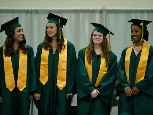 Golden Flame finalists from left to right, Annabella Aline, Mackenzie George, Cecelia Grasseschi and Ayana Gray during the C.M. Russell High School Class of 2018 commencement ceremony on Sunday, May 27, 2018, in the Four Seasons Arena.  CMR graduated 287 seniors on Sunday.