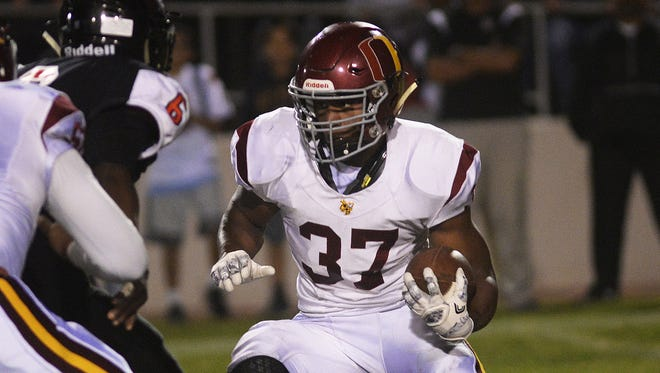 Oxnard's Danny Smith makes a cutback against Rio Mesa in a showdown between Pacific View League rivals last Friday night. Area schools are hoping a recent trend of lower attendance at high school sports events will not continue.