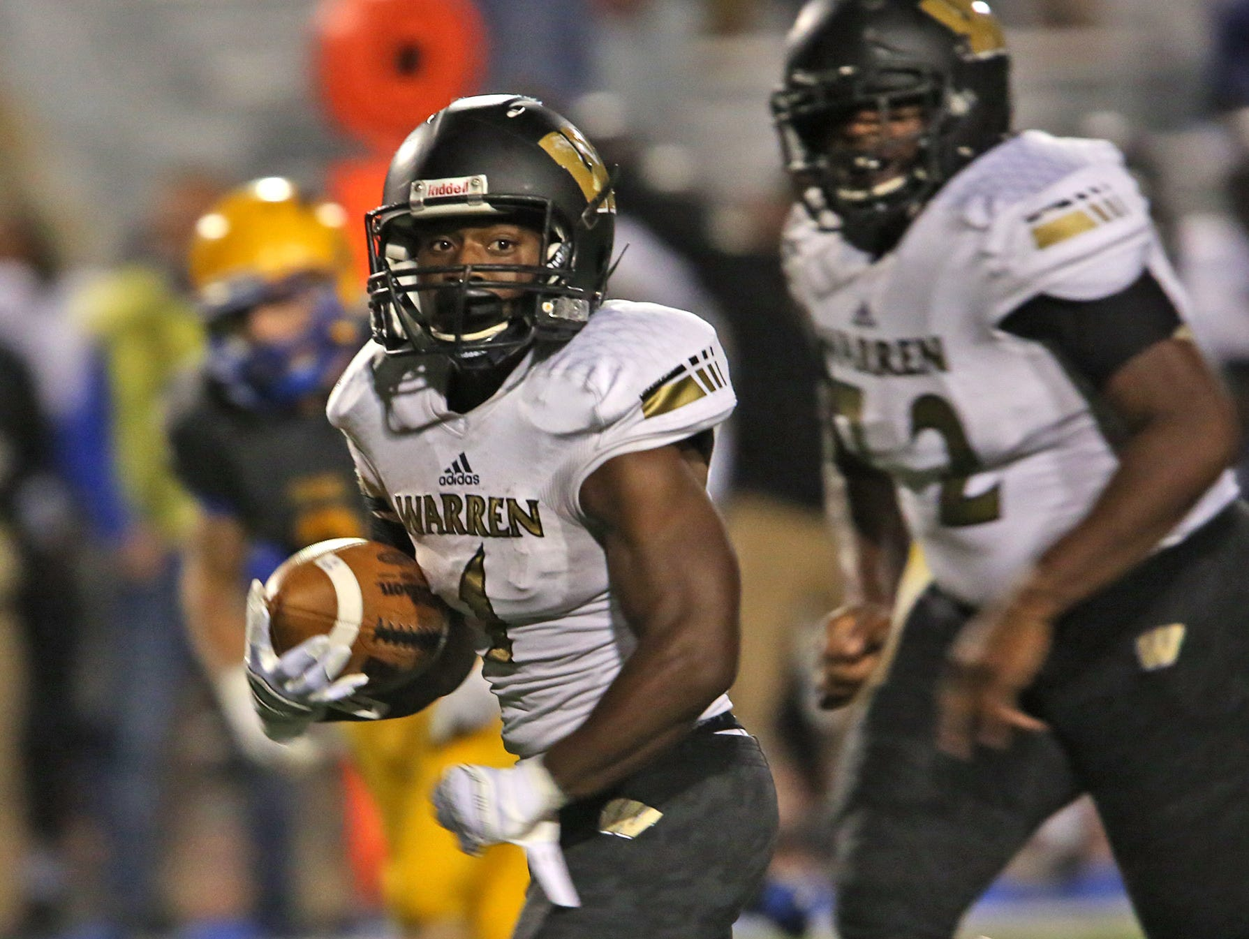 Warren Central's #1 Jay Coe breaks out for a 42-yard touchdown run in first half during the Warren Central at Carmel High School football game, Friday, October 9, 2015.