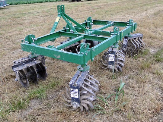Strawberry growing requires specialized equipment like this tiller that trims plants according to the sought-after row width.