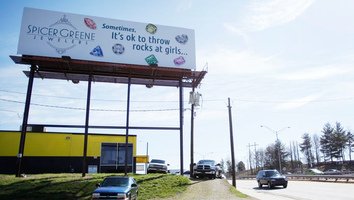 """The Spicer Greene Jewelers billboard on 240 East near Westgate reads """"Sometimes, it's okay to throw rocks at girls..."""" March 23, 2017."""
