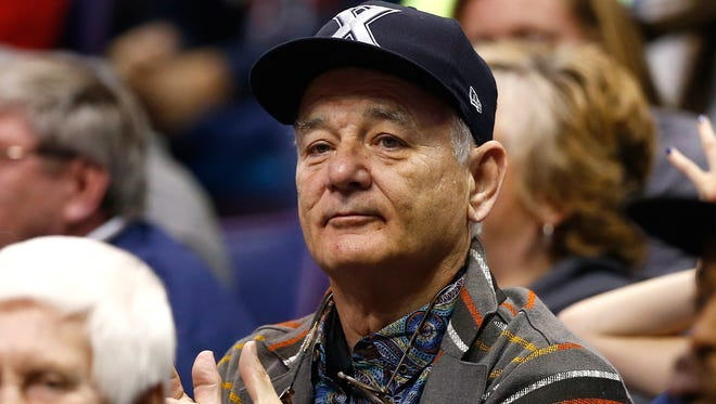 Actor Bill Murray attends the game between the Xavier Musketeers and the Wisconsin Badgers during the second round of the 2016 NCAA Men's Basketball Tournament at Scottrade Center on March 20, 2016 in St Louis, Missouri. Murray's son Luke Murray is an assistant coach for the Musketeers.  (Photo by Jamie Squire/Getty Images)