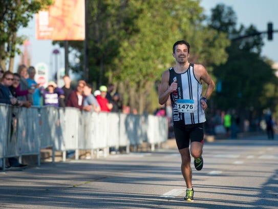 Evansville Half Marathon winner Chase Broughton nears