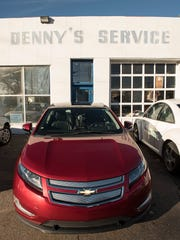 The Volt sits in front of Denny's Service Center almost