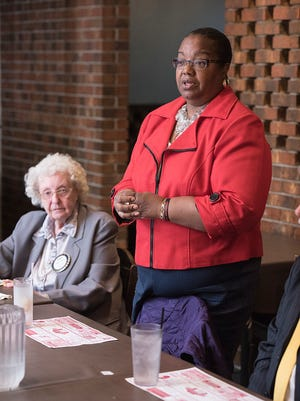 Kym Worthy speaks to the Garden City Rotary Club. At left is Rotarian Wilma Healy.