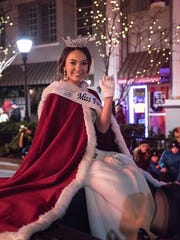 Grace Murphy, the reigning Miss Farmington, rides in