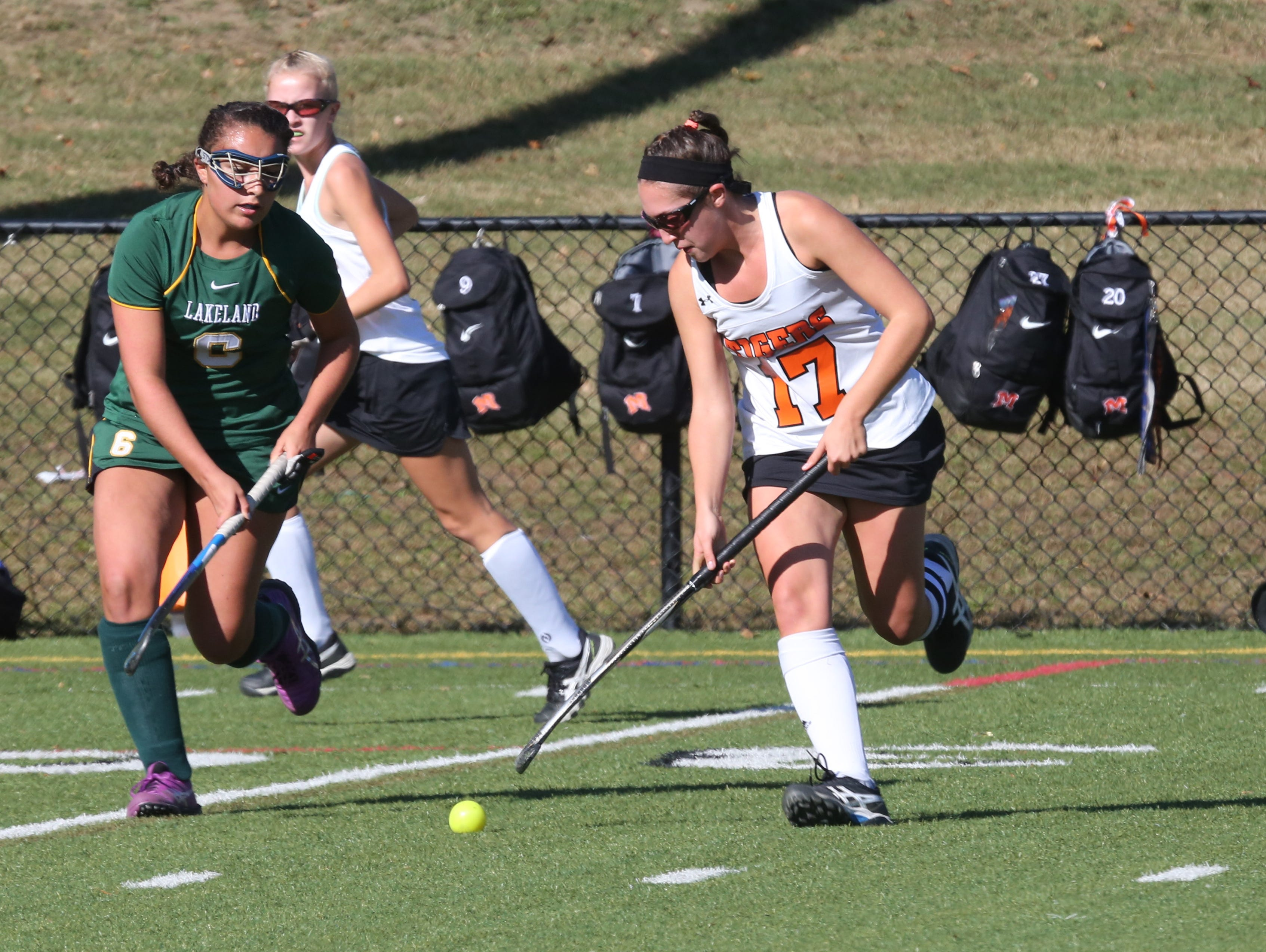 Lakeland's Emily Kness, left, and Mamaroneck's Paige Danehy chase down a ball during their game in Mamaroneck Saturday.