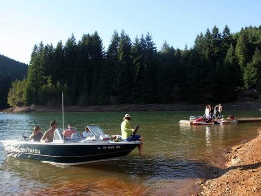 Boaters shove off during a sunny afternoon on Green Peter Reservoir.