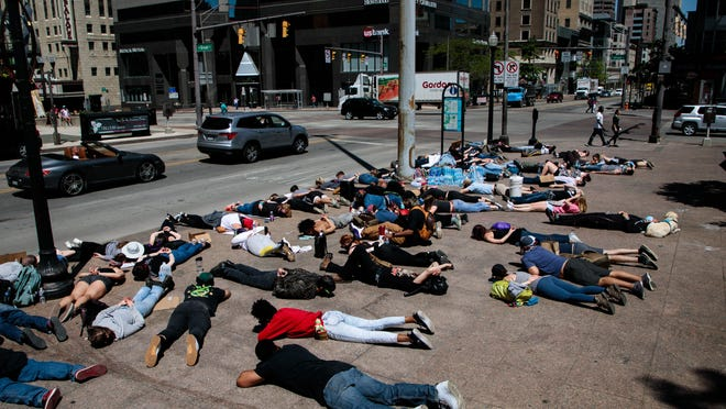 "Demonstrators lay face down on the sidewalk as protests continue following the death of Minneapolis resident George Floyd on Monday, June 1, 2020 in Columbus, Ohio. Floyd, a 46-year-old black man, was killed while in police custody after allegedly passing a counterfeit $20 bill at a conveinence store. Derek Chauvin, one of four Minneapolis police officers involved in Floyd's arrest, has himself been arrested and charged with third-degree murder and manslaughter. During the arrest, video footage showed Chauvin kneeling on Floyd's neck for almost nine minutes as Floyd repeatedly said ""I can't breathe."""