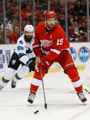 Detroit Red Wings center Riley Sheahan skates against San Jose Sharks in the first period of an NHL hockey game in Detroit, Saturday, Oct. 22, 2016.