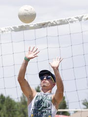 Tommy Montoya gets in a good shot during a volleyball match as a part of  recent Senior Day activities at Mayfield High School. The volleyball equipment was provided by the city's mobile recreation unit.