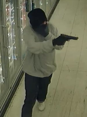 Tulare County sheriff's deputies are searching for two armed men suspected of robbing a Strathmore liquor store.