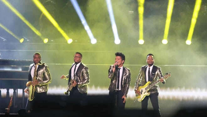 Feb 2, 2014; East Rutherford, NJ, USA; Recording artist Bruno Mars performs during the during the half time show in Super Bowl XLVIII at MetLife Stadium.   Mandatory Credit: Matthew Emmons-USA TODAY Sports ORG XMIT: USATSI-131860 ORIG FILE ID:  20140202_ajl_se2_314.JPG