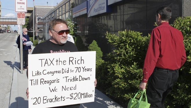 FILE - In this April 17, 2012, photo, James Hodgkinson of Belleville protests outside of the United States Post Office in Downtown Belleville, Ill. A government official says the suspect in the Virginia shooting that injured Rep. Steve Scalise and several others has been identified Hodgkinson. (Derik Holtmann/Belleville News-Democrat, via AP)