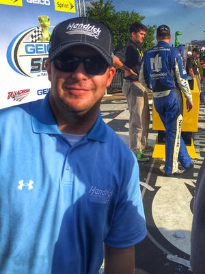 TJ Majors, spotter for Dale Earnhardt Jr., celebrates in victory lane after Earnhardt won Sunday's GEICO 500.