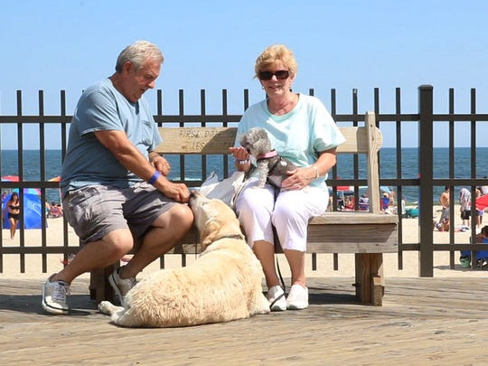 "Ken and Carol Sudol of Whiting with their dogs Sophie and KC. Seaside Heights allowed dogs to roam the beach and boardwalk during the celebration of ""National Dog Day"" last year and will continue the event this August with ""Dog Royalty Days."""