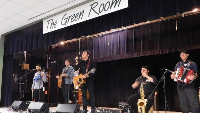 Orkesta Mendoza performs for students at Fort Braden school.