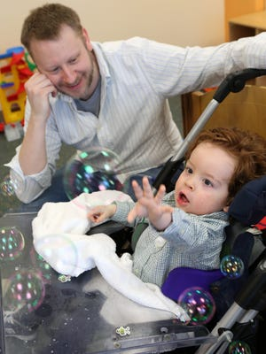 David Schloeffel watches his son, Harrison, reach for a bubble during song time at Mount Pleasant Blythedale School (MPB) in Valhalla. The school provides educational opportunities for inpatients and other young students with intensive medical needs.