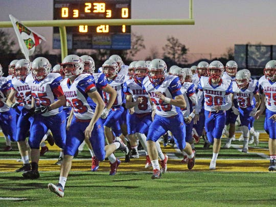 The Roncalli Rebels take the field against Greenwood