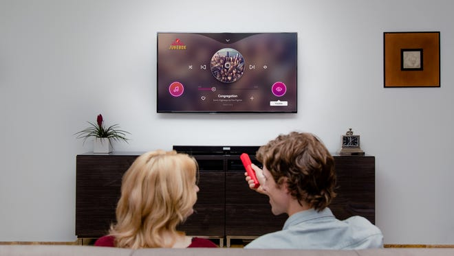 A photo illustration showing the Electric Jukebox music service being used in a living room.