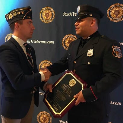 Montclair Police Officer Kevin Ortiz, right, receives