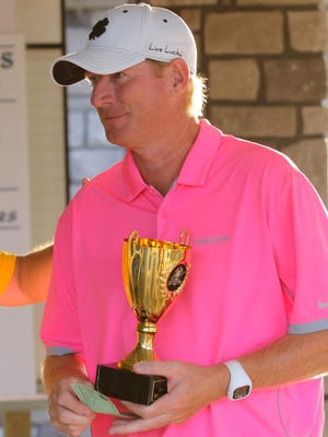 Kevin Cook holds the trophy for winning the Twin Tiers Championshi at Soaring Eagles Golf Course on Sunday.