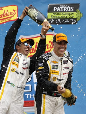 Sahlen's Six Hours of The Glen winners Christian Fittipaldi and Joao Barbosa celebrate in victory lane at Watkins Glen International.