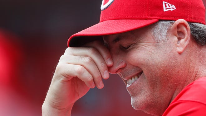 Cincinnati Reds manager Bryan Price reacts in the dugout in the second inning of a baseball game against the Colorado Rockies, Sunday, May 21, 2017, in Cincinnati.