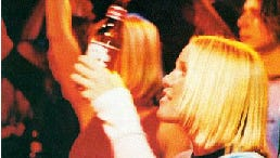 In a August 2003 advertisement in SPIN, Anheuser-Busch promoted Budweiser beer with a young woman at a concert.