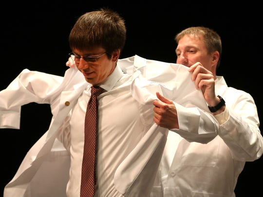 Seth Heithaus is coated during the Medical College of Wisconsin Central Wisconsin White Coat Ceremony at UW Marathon County, in Wausau, Wisconsin, July 7, 2016.
