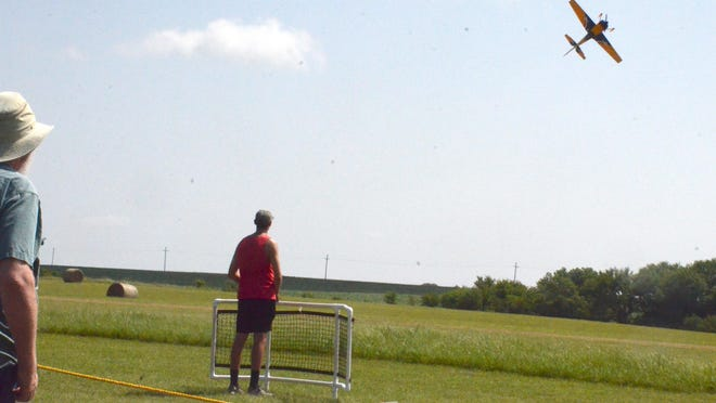 Nick Scharping, a radio control pilot from Wichita, spent his Saturday morning at Harvey County East Lake showing his precision flying skills during an anniversary celebration for the radio control park at East Park.