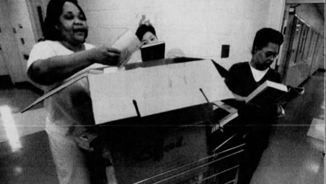 A file photo from 2001 shows Catherine Culp (left) looking at a shipment of books to Baylor Women's Correctional Institution. The Delaware Supreme Court ruled last week that a Superior Court judge erred by releasing Culp early from her sentence.