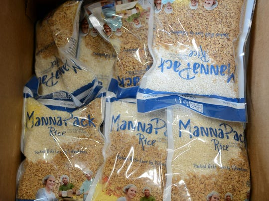 A box of measured and packaged meals at the Feed My Starving Children MobilePack.