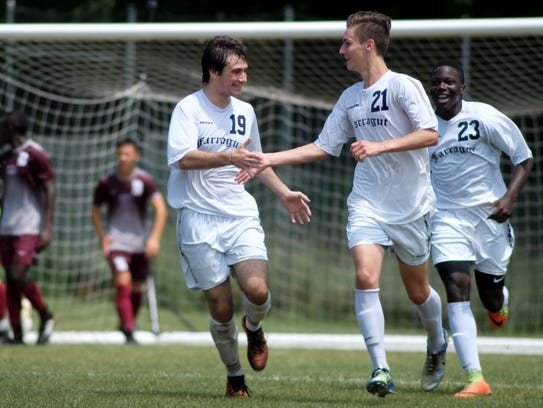 Farragut's Wes Jeter (21) receives praise from Arda