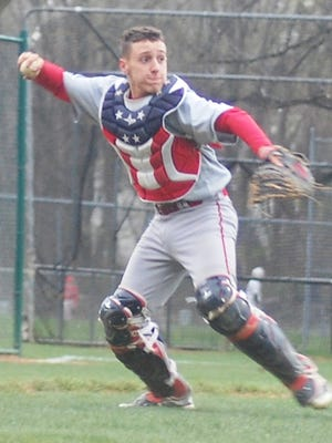 Fair Lawn freshman Ryan Perez throwing to first after a bunt attempt by Passaic Valley in a Big North game April 19.