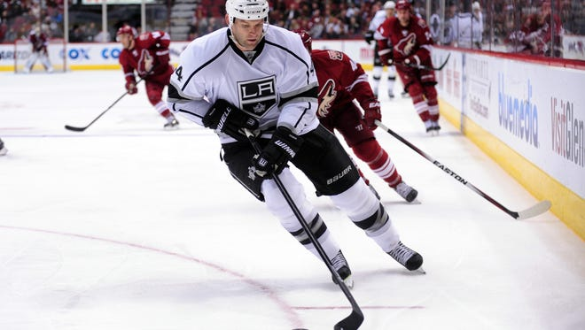 Los Angeles Kings defenseman Robyn Regehr (44) carries the puck during the second period against the Arizona Coyotes at Gila River Arena.