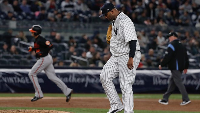 New York Yankees pitcher CC Sabathia stands on the mound after giving up a solo home run to Baltimore Orioles' Manny Machado during the third inning of a baseball game Friday, April 6, 2018, in New York.