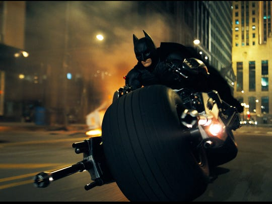 Batman on his Bat-Pod in 'The Dark Knight.'