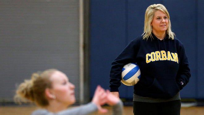 Corban head coach Kim McLain watches practice, Monday, October 26, 2015, at the C.E. Jefferson Sports Center in Salem, Ore.