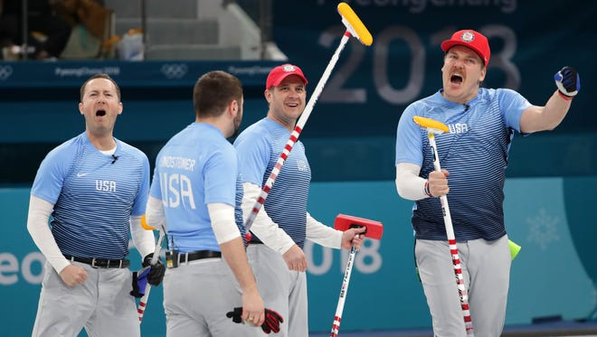 Team USA celebrates after defeating Canada in the men's curling semifinals.