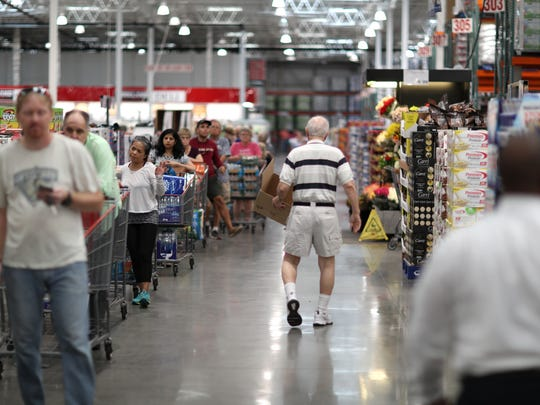 Shoppers fill the checkout lines at Costco, where the store had sold out on batteries, bottled water and generators before Hurricane Irma.